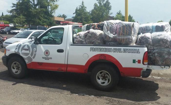 Dan apoyo a damnificados por inundaciones en Tangancícuaro